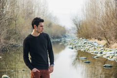 Attractive young man outdoor in nature, at river Stock Images