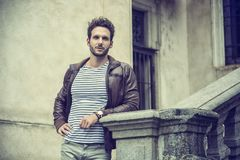 Attractive young man outdoor wearing leather jacket Stock Photo