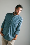 Attractive young man with plaid shirt. Stock Photo