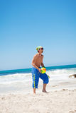 Attractive young man playing volleyball on the beach Stock Photo