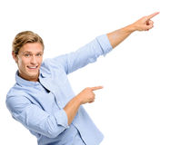 Attractive young man pointing isolated on white background Royalty Free Stock Images