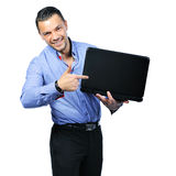 Young man pointing on notebook computer. Isolated on Stock Images
