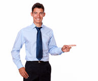 Attractive young man pointing to his left Royalty Free Stock Photos