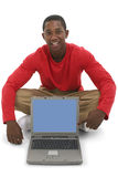 Attractive Young Man Pointing To Laptop Screen Stock Photography