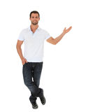 Attractive young man pointing to the side Royalty Free Stock Photos