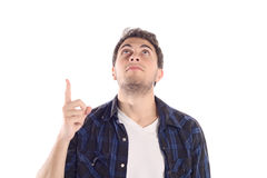 Attractive young man pointing up. Stock Photos