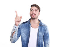 Attractive young man pointing up surprised Royalty Free Stock Photo