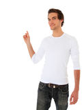Attractive young man points to the side Stock Photography