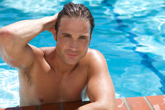 Attractive Young Man in Pool Royalty Free Stock Photos