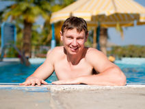 Attractive Young man in the pool Royalty Free Stock Image