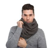 Attractive young man posing with gray wool scarf Stock Image