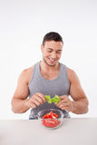 Attractive young man is preparing healthy food Royalty Free Stock Photos