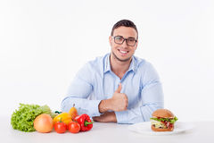 Attractive young man with pretty smile is very Stock Images