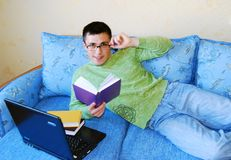 Attractive young man reading a book. Stock Photos