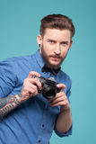 Attractive young man is ready to photograph Royalty Free Stock Photography