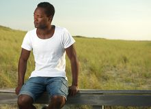 Attractive young man relaxing outdoors Royalty Free Stock Image
