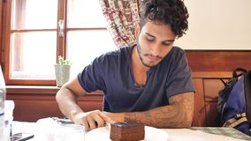 Attractive young man in restaurant eating Stock Photography