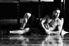 Attractive Young Man Resting In Gym Afther Exercise Royalty Free Stock Photos
