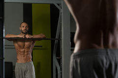 Attractive Young Man Resting Relaxed In Gym Royalty Free Stock Images