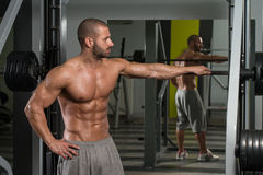 Attractive Young Man Resting Relaxed In Gym Royalty Free Stock Photo