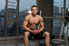 Attractive Young Man Resting Relaxed In Gym Stock Photo