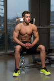 Attractive Young Man Resting Relaxed In Gym Royalty Free Stock Image