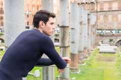 Attractive young man in Rome, Italy, looking at Stock Photography