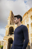 Attractive young man in Rome standing in front of Royalty Free Stock Photos