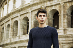 Attractive young man in Rome standing in front of Royalty Free Stock Photo