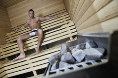 Attractive young man in sauna Stock Image