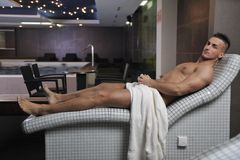 Attractive young man in sauna Royalty Free Stock Image