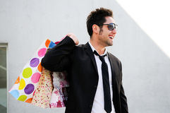 Attractive young man with shopping bags Royalty Free Stock Image