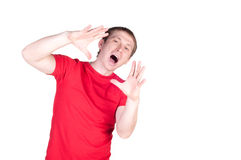 Attractive young man shouting. Isolated on white background Royalty Free Stock Photos