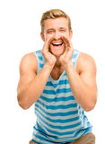 Attractive young man shouting - isolated on white background. Happy attractive young man shouting stock image