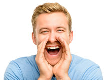 Attractive young man shouting - isolated on white background Stock Images