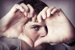 Attractive Young Man Show Love Sign Stock Photography