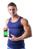 Attractive young man showing his cell phone's Stock Photo