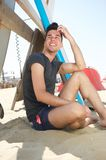 Attractive young man sitting at the beach Royalty Free Stock Image