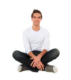 Attractive young man sitting on the floor Royalty Free Stock Photography