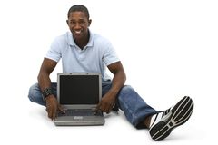 Attractive Young Man Sitting On Floor with Laptop Computer royalty free stock photo