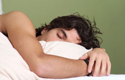 Attractive young man is sleeping peacefully Stock Images