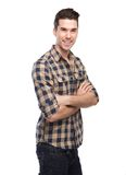 Attractive young man smiling with arms crossed Stock Image