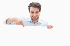 Attractive young man smiling and holding poster Stock Images