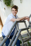 Attractive young man smiling in urban background Royalty Free Stock Photography