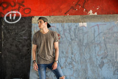 Attractive young man standing against wall Stock Image