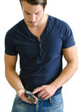 Attractive young man standing with compass in his hand Royalty Free Stock Image