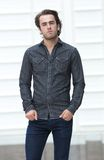 Attractive young man standing outside alone Stock Photos