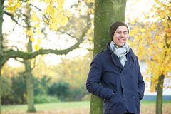 Attractive young man standing outside on an autumn day Stock Photo
