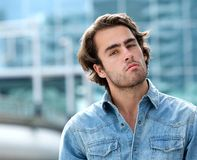 Attractive young man standing outside Royalty Free Stock Photo