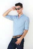 Attractive young man standing outside with sunglasses Stock Photo